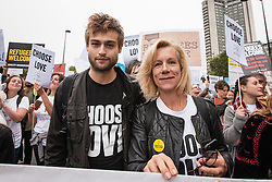© Licensed to London News Pictures. 17/09/2016. London, UK. Actress JULIET STEVENSON (R) and Actor DOUGLAS BOOTH (L) join thousands as they march through central London to call on the government to welcome refugees to the UK. Photo credit: Rob Pinney/LNP
