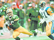 (Published caption 11/10/97) Packers Antonio Freeman hauls in a pass as Rams cornerback Todd Lyght tries to catch up.<br /> <br /> (Published caption 11/27/97) In the past three games, Packers receiver Antonio Freeman has caught 15 passes for 309 yards and five touchdowns -- his best stretch of the season.
