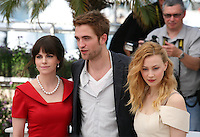 Emily Hampshire, Robert Pattinson, Sarah Gadon  at Cosmopolis photocall at the 65th Cannes Film Festival France. Cosmopolis is directed by David Cronenberg and based on the book by writer Don Dellilo.  Friday 25th May 2012 in Cannes Film Festival, France.
