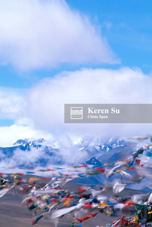 Praying flags, the Himalayas Range at background, Tangla Pass, Tibet, China