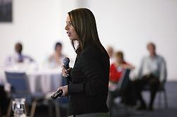 Young woman speaker at an NHS Training event on staff development,