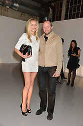 NOELLE RENO and SCOT YOUNG at the Audemars Piguet Royal Oak Offshore 42mm Party held at Victoria House, Bloomsbury Square, London on 23rd April 2014.