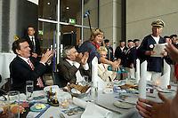 27 APR 2004, BERLIN/GERMANY:<br /> Gerhard Schroeder (L), SPD, Bundeskanzler, und Jann-Peter Janssen (2.v.L), MdB, SPD, aus dem ostfriesischen Wahlkreis Aurich-Emden, applaudieren dem Loppersumer Shantychor, waehrend dem Eroeffnungsabend der 1. kulinarischen Ostfriesland-Woche, Abgeordneten-Restaurant des Deutschen Bundestages, Rechstagsgebaeude<br /> IMAGE: 20040427-04-010<br /> KEYWORDS: Gerhard Schröder, Regional-Marketing Norderfleisch, Parlamentarischer Abend