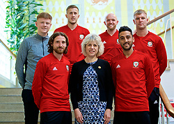 WREXHAM, WALES - Wednesday, June 5, 2019: Glyndwr University Vice-Chancellor Dr Maria Hinfelaar (C) with Wales' Joe Allen, Will Vaulks, Jonathan Williams, Neil Taylor and two students at Glyndwr University ahead of the UEFA Euro 2020 Qualifying Group E match between Croatia and Wales. (Pic by David Rawcliffe/Propaganda)