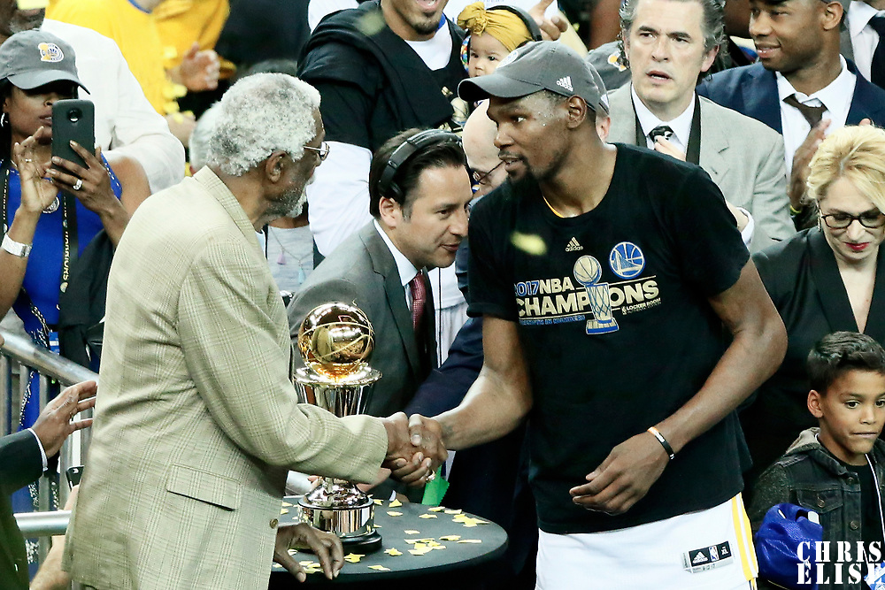 12 June 2017: Golden State Warriors forward Kevin Durant (35) is seen with Bill Russell during the Golden State Warriors 129-120 victory over the Cleveland Cavaliers, in game 5 of the 2017 NBA Finals, at the Oracle Arena, Oakland, California, USA.