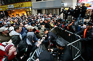 Police try to keep fans back at a rally to celebrate the final broadcast on FM radio in New Yorkspeaks to the crowd durring a rally 16 December 2005.After 21 years on the air and millions of dollars of fines from the FCC, Stern signed a $500 million 5-year deal with the largely unregulated  Sirius satellite radio which begins broadcasts