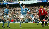 Photo. Aidan Ellis.<br /> Manchester City v Manchester United.<br /> FA Barclaycard Premiership.<br /> 14/03/2004.<br /> City's Jon Macken and Steve Mcmanaman celebrate the second goal