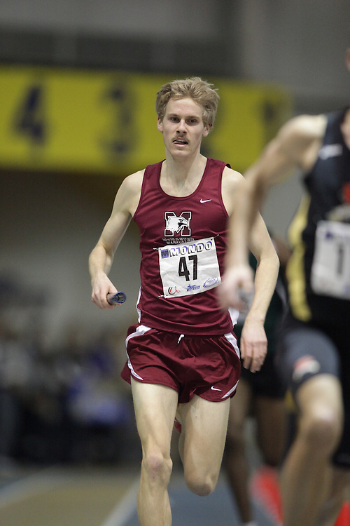 Windsor, Ontario ---13/03/09--- Andrew Douglas of  McMaster University competes in the 4X800 metre relay at the CIS track and field championships in Windsor, Ontario, March 13, 2009..GEOFF ROBINS Mundo Sport Images
