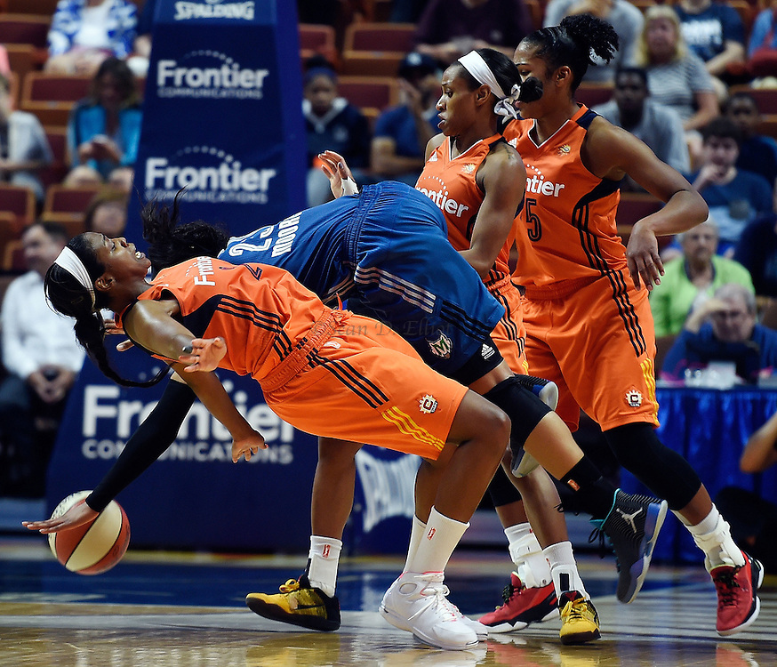7/7/16 :: SPORTS :: GRIFFEN :: Connecticut's Camille Little draws an offensive foul on Minnesota's Maya Moore giving the Sun the ball with the lead in the final seconds of overtime in WNBA action Thursday, July 7, 2016 at Mohegan Sun Arena. The Sun came back to take a 93-89 overtime win over the defending WNBA champion Lynx. (Sean D. Elliot/The Day)