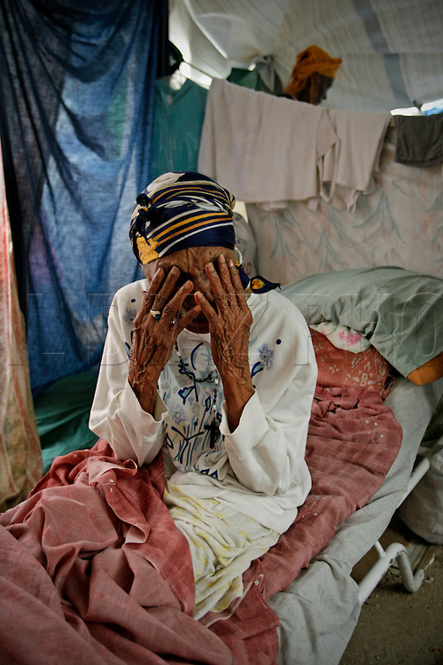 A  blind great grandmother Frezilia Cetoute, 109, (cq all) inside her makeshift tent on a former soccer field at Sainte Therese Park in Petion-Ville on February 27, 2010. She and her family has been surviving with remittances from relatives in Miami. Cetoute says the earthquake has been the hardest loss of her life. Even though she is blind Cetoute was able to move around her house with ease. Now she feels stuck in a tent.