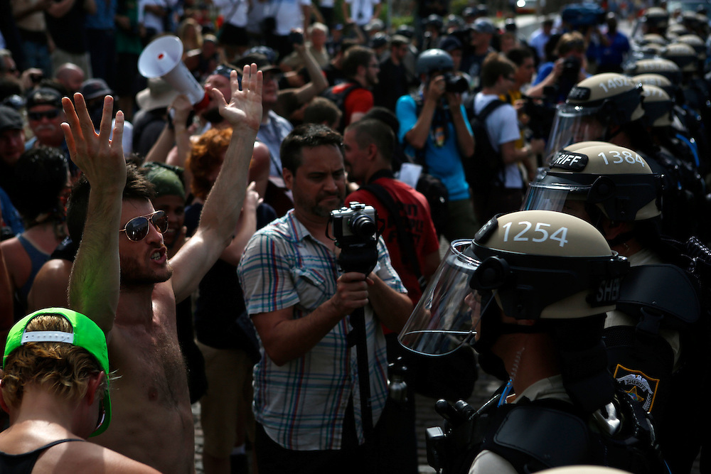 John Murdock 37, a comedian from New York City and member of Occupy Wall Street, yells at members of the Westboro Baptist Church during the 2012 Republican National Convention on August 28, 2012 in Tampa, Fla. Westboro Baptisit Church members are known for their inflammatory views. Florida law enforcement officers stood between the two groups.