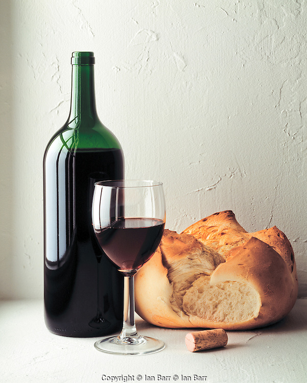 Still Life of bread and wine by a window