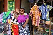 Asia Diwala with her employee outside their Batik shop.<br /> <br /> Asia owns and runs a Batik business in KwaMatias, Tanzania.<br /> <br /> She attended MKUBWA enterprise training run by the Tanzania Gatsby Trust in partnership with The Cherie Blair Foundation for Women.