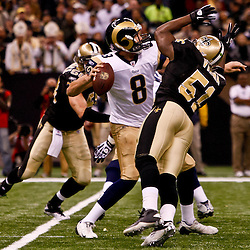 December 12, 2010; New Orleans, LA, USA; New Orleans Saints linebacker Jonathan Vilma (51) pressures St. Louis Rams quarterback Sam Bradford (8) during the first half at the Louisiana Superdome. Mandatory Credit: Derick E. Hingle-US PRESSWIRE