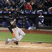 NEW YORK, NEW YORK - APRIL 12: Dee Gordon, Miami Marlins, scores the winning run during the Miami Marlins Vs New York Mets MLB regular season ball game at Citi Field on April 12, 2016 in New York City. (Photo by Tim Clayton/Corbis via Getty Images)