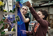 A student and Valerie Bonasso, staff, work on a trellis for an upcoming play at the Univeristy of Windsor School of Dramatic Art.