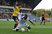 Ade Azeez of AFC Wimbledon is fouled by Paul Robinson of AFC Wimbledon during the Sky Bet League 2 match between Oxford United and AFC Wimbledon at The Kassam Stadium, Oxford, England on 10 October 2015. Photo by Stuart Butcher.