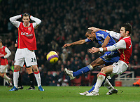 Photo: Tom Dulat/Sportsbeat Images.<br /> <br /> Arsenal v Chelsea. The FA Barclays Premiership. 16/12/2007.<br /> <br /> Cesc Fabregas of Arsenal and Ashley Cole of Chelsea fight for the ball. Nicklas Bendtner of Arsenal is watching them.
