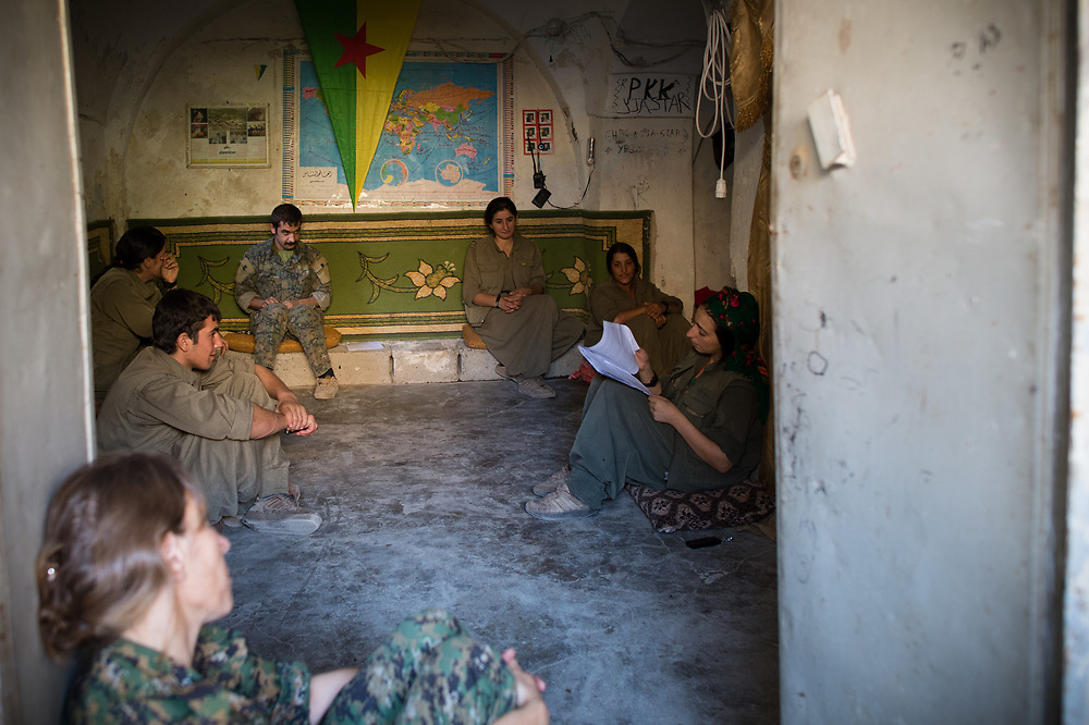 In a room in Shingal City, members of People's Defence Forces and Sinjar Resitance Units participate in a political training. Shingal (Sinjar), Iraq, August 27, 2015