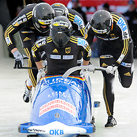 28 February 2007:     The Germany 3 bobsled driven by Thomas Florschuetz with sidepushers Marc Kuehne and Enrico Kuehn, and brakeman Alexander Metzger jump into the sled at the start of the 2nd run at the 4-Man World Championships competition on February 27 at the Olympic Sports Complex in Lake Placid, NY.