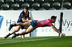 Tasman's Will Jordan, right, dives in to score a try under the attention of Otago's Fletcher Smith in the Mitre 10 Cup rugby match, Forsyth Barr Stadium, Dunedin, New Zealand, Sept. 16 2017.  Credit:SNPA / Adam Binns ** NO ARCHIVING**