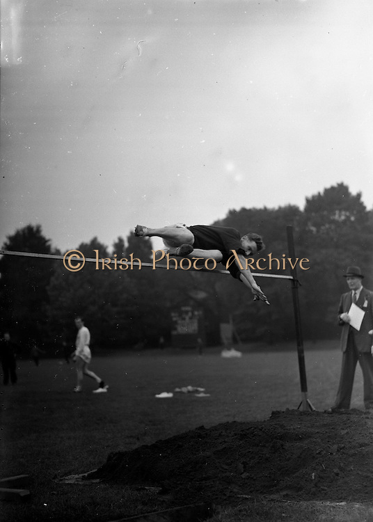 21/09/1957<br /> 09/21/1957<br /> 21 September 1957<br /> Athletics - Ireland V Scotland in College Park, Trinity College, Dublin.  The High Jump.