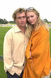 Model JODIE KIDD and MR TARQUIN SOUTHWELL at a polo match in Sussex on 23rd July 2000.OGI 54