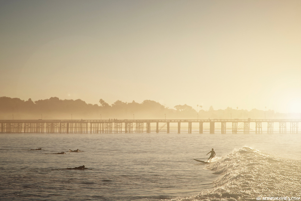 A dawn patrol surf session at the local break in Ventura, California.