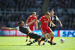 NEWCASTLE-UPON-TYNE, ENGLAND - Sunday, April 1, 2012: Liverpool's Craig Bellamy in action against Newcastle United's Jonas Gutierrez during the Premiership match at St James' Park. (Pic by David Rawcliffe/Propaganda)