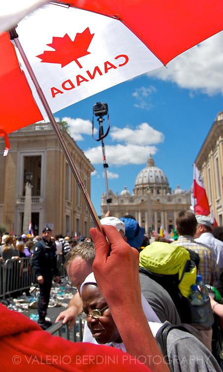 A man from Canada repair from the hot Italian sun under colourful umbrellas