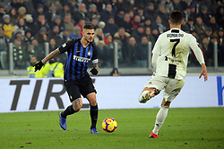 December 7, 2018 - Turin, Turin, Italy - Mauro Icardi #9 of FC Internazionale Milano competes for the ball with Cristiano Ronaldo #7 of Juventus FC during the serie A match between Juventus FC and FC Internazionale Milano at Allianz Stadium on December 07, 2018 in Turin, Italy. (Credit Image: © Giuseppe Cottini/NurPhoto via ZUMA Press)