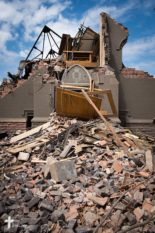 Debris spills from the entrance of Zion Lutheran Church on Tuesday, May 12, 2015, in Delmont, S.D. A tornado swept through the area on Sunday and destroyed the church along with nearby buildings. LCMS Communications/Erik M. Lunsford