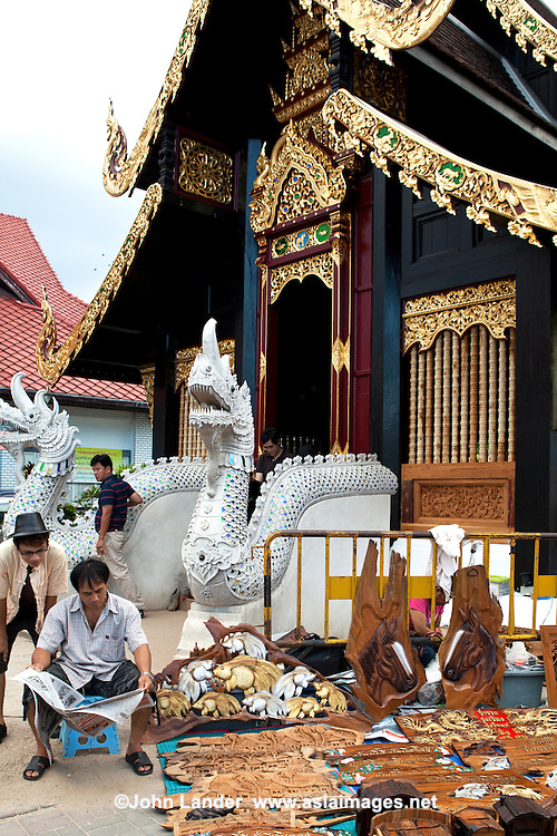 Chiangmai Sunday Walking Market, takes place along Rajdamneon Road on Sundays from around 4 pm till 11 at night. The street is blocked off to traffic for local craft vendors to display their handmade wares.  Also known as the Sunday Market,  local crafts are displayed and sold. Within the temple compounds along the street you can also sample Northern Thai food and snacks.