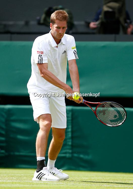 Wimbledon Championships 2013, AELTC,London,<br /> ITF Grand Slam Tennis Tournament,Florian Mayer(GER),Aktion,Einzelbild,Ganzkoerper,Hochformat,