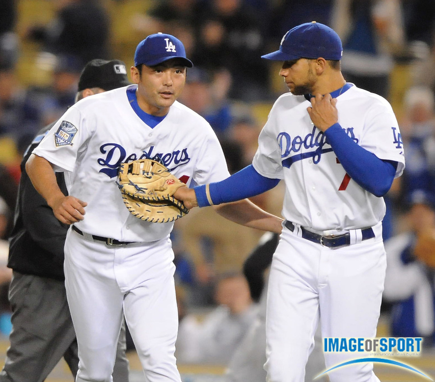 Apr 16, 2008; Los Angeles, CA, USA; Los Angeles Dodgers reliever Takashi Saito (44), left, and first baseman James Loney (7) celebrate after 8-1 victory over the Pittsburgh Pirates at Dodger Stadium.