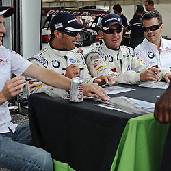 Rahal Letterman Lannigan BMW drivers (left-right) Dirk Werner, Bill Auberlen, Joey Hand and Dirk Mueller sign autographs during the 2011 American LeMans Series Baltimore Grand Prix weekend.