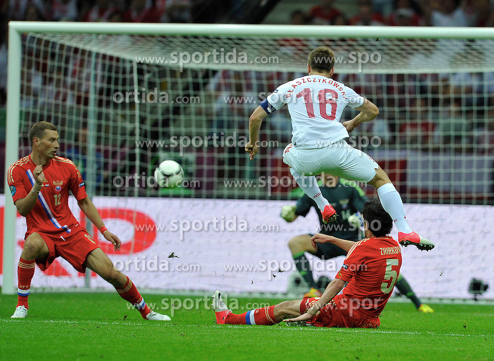 Warsaw 12/06/2012.POLAND, WARSAW .Jakub Blaszczykowski scores a goal for Poland during the Euro 2012 football championships match Poland vs. Russia, on June 12, 2012 at the National Stadium in Warsaw. .Photo by: Piotr Hawalej / WROFOTO