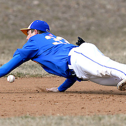Staff photos by Tom Kelly IV<br /> Springfield third baseman Nick Gorman (33) comes up short diving for this hard hit ground ball up the line during the Springfield at Cardinal O'Hara baseball game on Tuesday afternoon, March 24, 2015.
