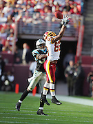 LANDOVER, MD - NOVEMBER 26:  Wide receiver Antwaan Randle El #82 of the Washington Redskins goes airborne with outstretched arms but just misses catching  a pass defended by safety Shaun Williams #36 of the Carolina Panthers at FedExField on November 26, 2006 in Landover, Maryland. The Redskins defeated the Panthers 17-13. ©Paul Anthony Spinelli *** Local Caption *** Antwaan Randle El;Shaun Williams