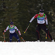 Winter Olympics, Vancouver, 2010. Ji-Hee Mun, Korea, (right) and Katja Haller, Italy  in action during the Women's 7.5 KM Sprint Biathlon at The Whistler Olympic Park, Whistler, during the Vancouver  Winter Olympics. 13th February 2010. Photo Tim Clayton