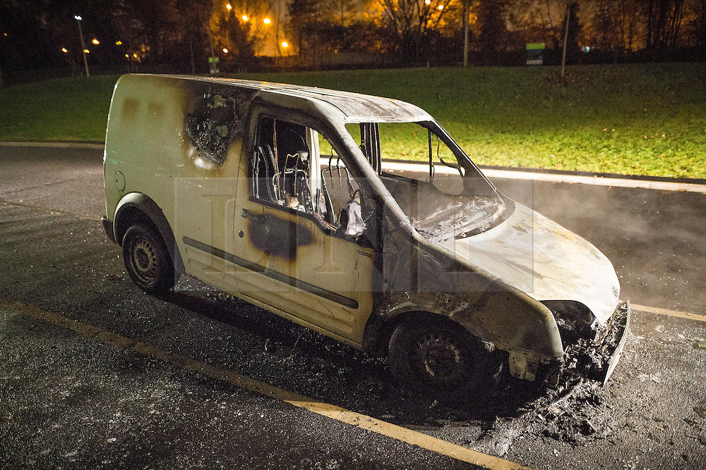 © Licensed to London News Pictures . 05/11/2015 . Salford , UK . A burned out Transit van on Graythorpe Walk . Manchester Fire reports receiving more than 300 calls in less than 7 hours, from 4.30pm, including to buildings, cars and wheelie bins set alight by arsonists . At some calls fire crews were subject to vandalism , including a hose being sliced whilst it was being used to fight a fire in Leigh and bricks being thrown at crews attending a job in Miles Platting . Fire crews deal with arson attacks across Greater Manchester during Bonfire Night . Photo credit : Joel Goodman/LNP