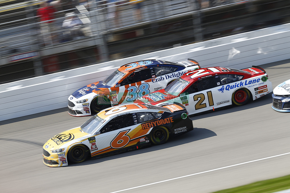 August 12, 2018 - Brooklyn, Michigan, United States of America - Trevor Bayne (6), Paul Menard (21) and David Ragan (38) battle for position during the Consumers Energy 400 at Michigan International Speedway in Brooklyn, Michigan. (Credit Image: © Chris Owens Asp Inc/ASP via ZUMA Wire)