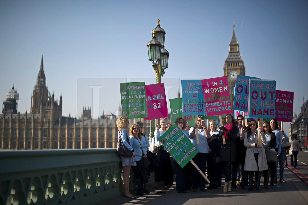 © London News Pictures.  05/03/2013. London, UK. Singer Alesha Dixon (front right) leads victims of domestic violence, families of victims and campaigners across Westminster Bridge to Parliament in London on the lead up to International Women's Day on March 8th. Photo credit: Ben Cawthra/LNP