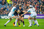 Simon Hickey (#10) of Edinburgh Rugby looks to break between Rob Harley (#6) of Glasgow Warriors and Fraser Brown (#2) of Glasgow Warriors during the 1872 Cup second leg Guinness Pro14 2019_20 match between Edinburgh Rugby and Glasgow Warriors at BT Murrayfield Stadium, Edinburgh,Scotland on 28 December 2019.