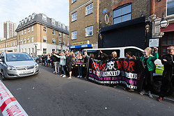 © Licensed to London News Pictures. 12/08/2015. London, UK. Led by activist group Class War, protesters, including local residents, women's groups from across London and historians demonstrate outside the Jack the Ripper museum in Cable Street, Shadwell to protest against the opening of a Jack the Ripper Museum. Six police officers and two private security staff are present outside the museum this evening. The museum sign has been removed and new black shutters installed. The original planning application for the museum stated that it would celebrate the historic, current and future contribution of women of the East End of London. Photo credit : Vickie Flores/LNP