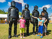 09 JANUARY 2016 - BANGKOK, THAILAND: Children pose with Thai Army special forces personnel during Children's Day festivities at the Royal  Thai Army's Palace Guard, 2nd Division Cavalry Base in Bangkok. National Children's Day falls on the second Saturday of the year. Thai government agencies sponsor child friendly events and the military usually opens army bases to children, who come to play on tanks and artillery pieces.        PHOTO BY JACK KURTZ
