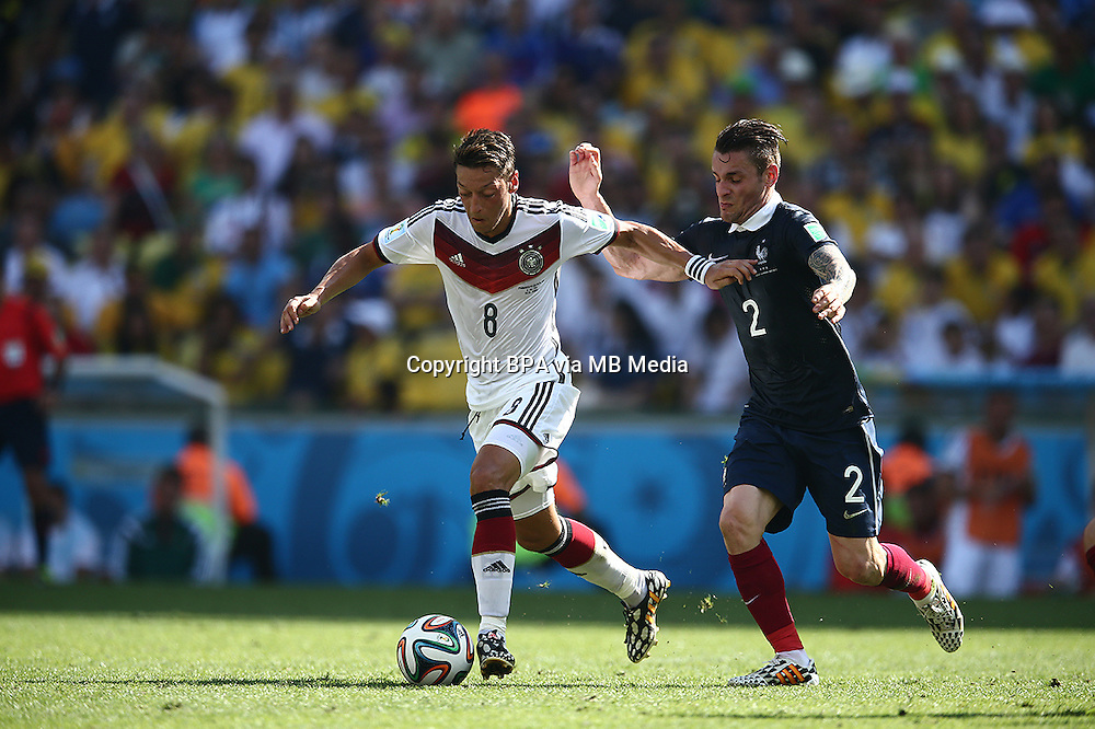 Mesut Oezil and Mathieu Debchy. France v Germany, quarter-final. FIFA World Cup Brazil 2014. 4 July 2014