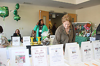 The Comer Children&rsquo;s Hospital Service League&rsquo;s annul Irish Coffee benefit and silent raffle was held this past Saturday at Augustana Lutheran Church located at 5500 S. Woodlawn.<br /> <br /> 0988 &ndash; Heather Refetoff checks out the silent auction materials.