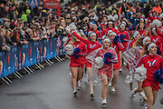 A large group of cheerleaders charge down Lower Regent Street - The New Years day parade passes through central London form Piccadilly to Whitehall. London 01 Jan 2017
