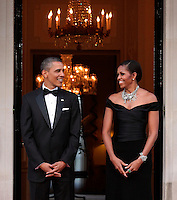 U.S. President Barack Obama and Michelle Obama wait to greet Queen Elizabeth ll and Prince Philip, Duke of Edinburgh for a Dinner at  Winfield House, the official residence of the US Ambassador, on May 25, 2011 in London, England. .................